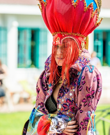 colorific: MOSCOW, RUSSIA - 18 MAY: Participant of annual carnival in Moscow in Ermitage Garden - woman in costume. Moscow, 18 may, 2013