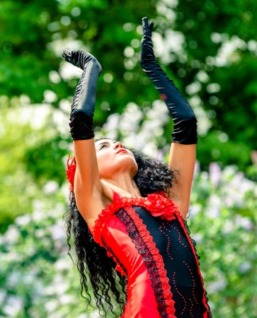 colorific: MOSCOW, RUSSIA - 18 MAY: Participants of annual carnival in Moscow in Ermitage Garden - woman dancing flamenco. Moscow, 18 may, 2013