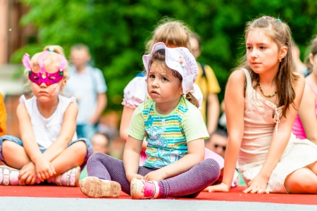 colorific: MOSCOW, RUSSIA - 18 MAY: Unidentified children watching annual carnival in Moscow in Ermitage Garden right on stage. Moscow, 18 may, 2013 Editorial