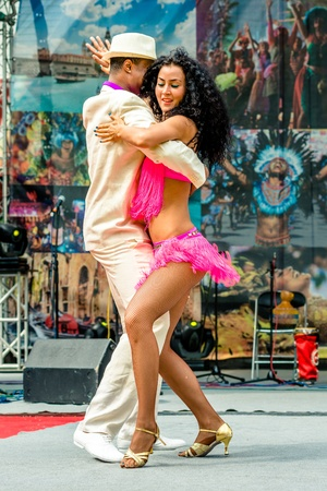 MOSCOW, RUSSIA - 18 MAY: Participants of annual carnival in Moscow in Ermitage Garden - latin dancers. Moscow, 18 may, 2013