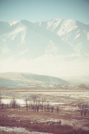 Valley and mountains country landscape in winter photo