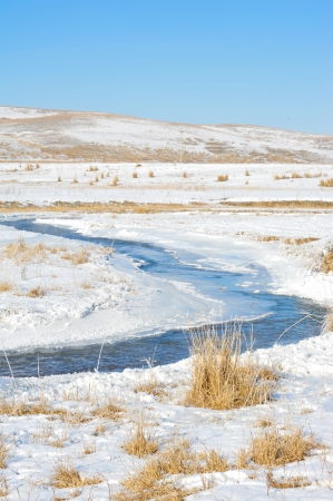 tortuous: Tortuous river partly covered with ice