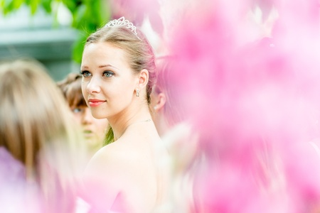 runaway: MOSCOW, RUSSIA - 25 MAY: Runaway Brides Cosmopolitan took place in Ermitage Garden. Bride through the blurred flowers. 25 May, 2013