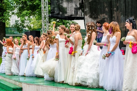 runaway: MOSCOW, RUSSIA - 25 MAY: Runaway Brides Cosmopolitan took place in Ermitage Garden. Brides ready to throw wedding bouquets. 25 May, 2013 Editorial