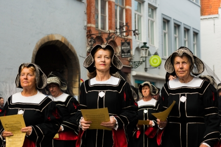 pilgrim costume: BRUGGE, BELGIUM - 9 MAY 2013: Procession of the Holy Blood in Bruges. Nuns singing. 9 of May, 2013