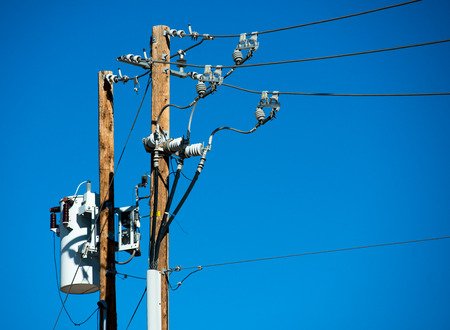 electric current: Detailed image of power lines and connections on a wooden post