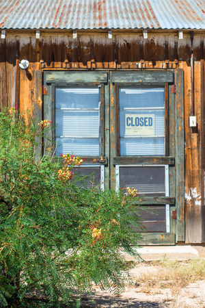 Old wooden door with hanging Closed sign photo