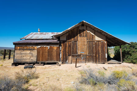Abandoned wooden house in the desert photo