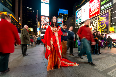 world's: NEW YORK - 22 MARCH 2014  Performer on the Times Square in Manhattan  Times Square, world s most visited tourist attraction is popular place among street performers