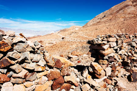 kaput: Inside the stone demolished cabin of old mine in Death Valley National Park