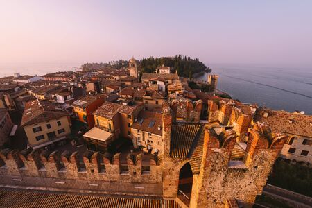 sirmione: Old town of Sirmione, Northern Italy during sunset