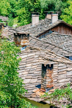 authentic: Authentic bulgarian roofs and chimneys Stock Photo