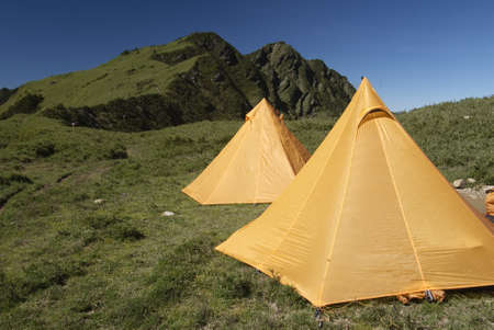 untitled key: Two yellow tents just standing on grassland in Taiwan National Park.