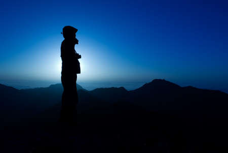 A silhouette of cameraman with golden light in the morning. photo