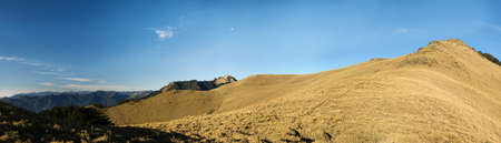 Beautiful panorama mountain landscape with golden grassland in morning. Stock Photo - 4553746
