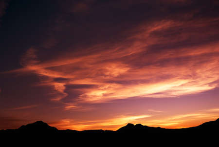 high mountain silhouette with beautiful colorful clouds. Stock Photo - 4573838