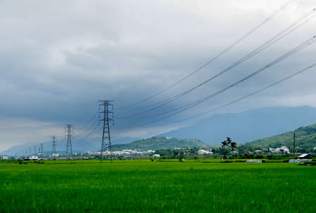 There are some electric towers on the farm. Stock Photo - 4747093
