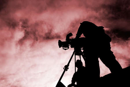 Here was a cameraman stand with silhouette. Stock Photo