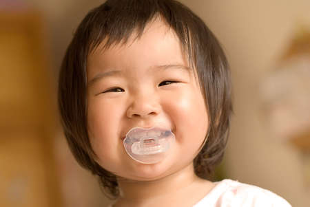 An asia baby was smiling looked so happy. Stock Photo