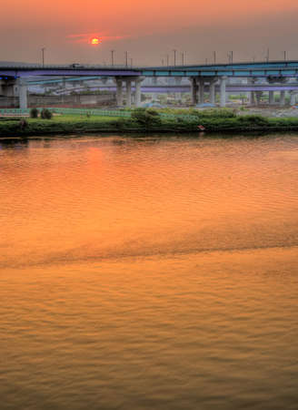 Here is city landscape of river sunset. photo