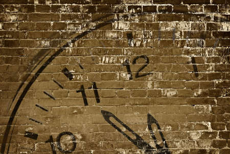 It is an old wall with clock sin. photo