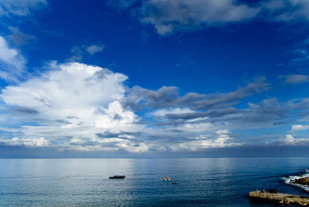 It is beautiful sky and ocean with fishing boats. photo