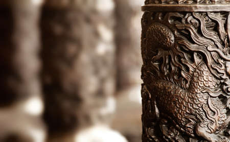 It is golden chinese style carving decoration in the pillar. photo