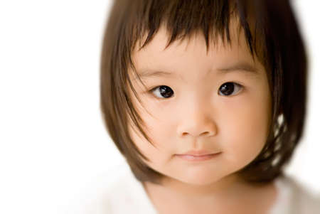 She is a beautiful Asian baby with innocent face. photo