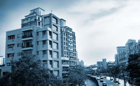 It is a beautiful cityscape contained roads and apartment. photo