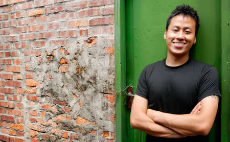 There is an Asian man stand against a old door and smile. photo