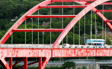 It is cityscape of cars in the red bridge. photo