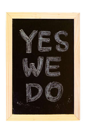 It is a blackboard written Yes,we do slogan. photo