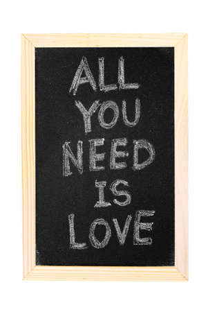 in need of space: It is a blackboard written All you need is love slogan.