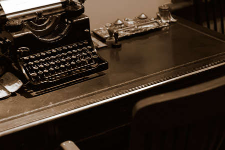 old desk: It is an old typewriter for bank on the desk.