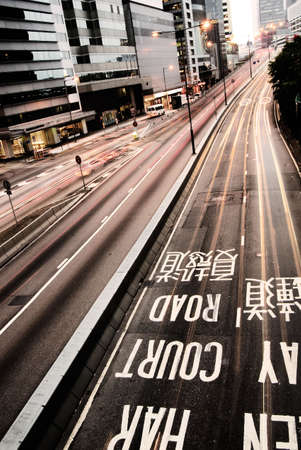 It is traffic with cars motion blurred and mark on the ground in Hong Kong. Stock Photo - 5767146