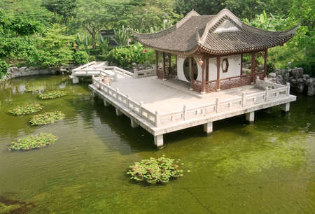 It is a Chinese building near the pond. Stock Photo - 5781797
