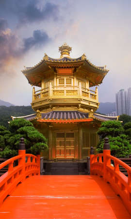 buddhist structures: Golden buddhism tower with red bridge and blue sky in China.