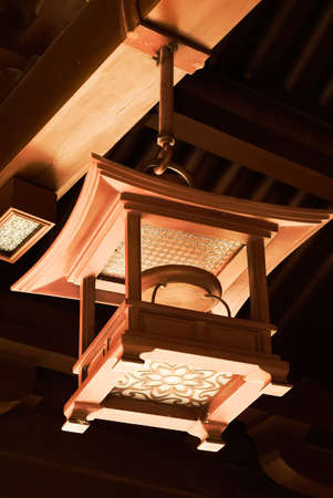 celling: Chinese traditional wooden brown lamp at the celling of temp.