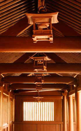 celling: Chinese traditional wooden brown lamp at the celling of temp in corridor