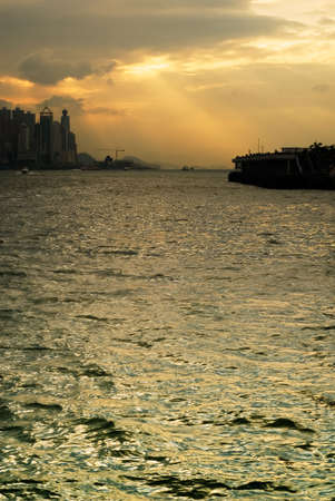 It is cityscape of Victoria harbor in Hong Kong. photo