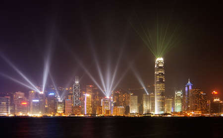 Famous night scenes of rays show on Victoria Harbor in Hong Kong. photo