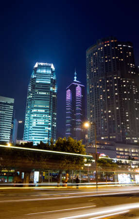 Beautiful night scenes of skyscraper with light and motion blurred of cars in Hong Kong. Stock Photo - 5844825