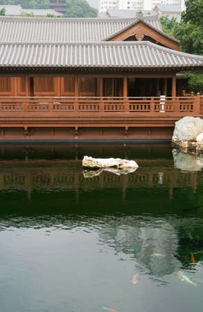 Traditional Chinese house made by wood near the pond. Stock Photo - 5844793