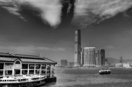 Black and white cityscape that one ferry berthed at Victoria Harbor in Hong Kong. photo