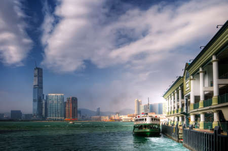 Ferry leave the dock Victoria Harbor in Hong Kong.  photo