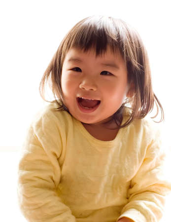 There is a happy Asian girl with smile in white background. photo
