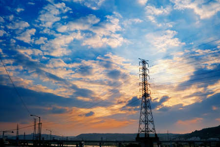 Sunset cityscape of power tower with beautiful clouds. Stock Photo - 5874085