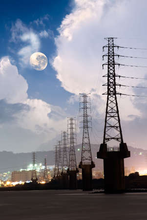 Dramatic cityscape of power tower in the night with beautiful cloud and moon near river. Stock Photo - 5874083