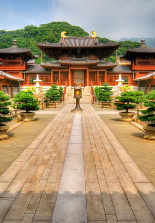 house of worship: Road toward Chinese traditional ancient temple and lamp in front of.