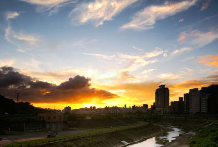 Beautiful cityscape of sunset with colorful cloud and blue sky in Taipei. photo